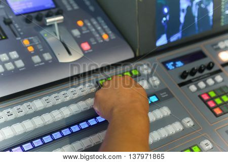 Tv Engineer Working Editing  With Video And Audio Mixer