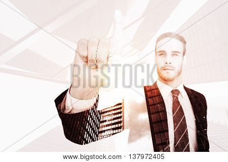 Unsmiling businessman in suit pointing up his finger against skyscraper
