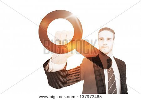 Unsmiling businessman in suit pointing up his finger against magnifying glass