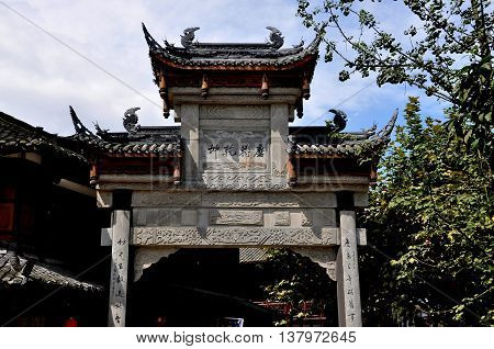 Jie Zi Ancient Town China - October 1 2010: One of several grand ceremonial gates with flying eave roofs and dragon figures that grace the ancient town streets