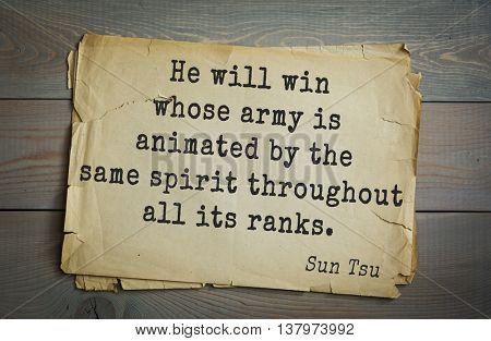 Ancient chinese strategist and philosopher Sun Tzu quote on old paper background. He will win whose army is animated by the same spirit throughout all its ranks.