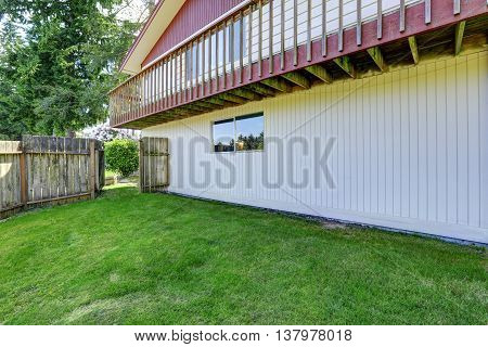 Spacious Backyard Area With Wooden Fence