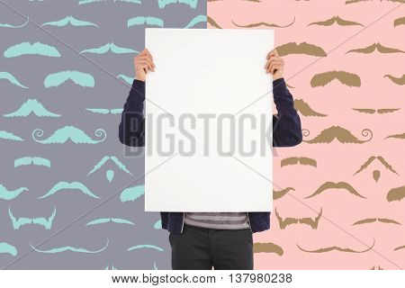 Man showing billboard in front of face against composite image of mustaches