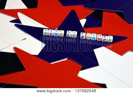 Happy Bastille Day with red white and blue french stars. Vive La France. French National Day at 14th July. La fête nationale française (le 14 Juillet le quatorze juillet)