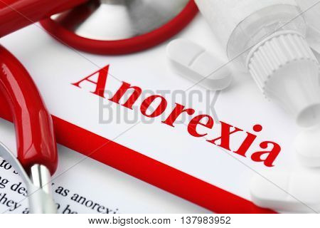 Anorexia concept. Medical supplies on paper background