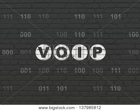 Web design concept: Painted white text VOIP on Black Brick wall background with Binary Code