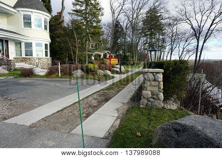 HARBOR SPRINGS, MICHIGAN / UNITED STATES - DECEMBER 25, 2015: East Bluff Drive ends in a private driveway at the edge of the bluff in Harbor Springs, Michigan.