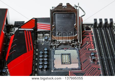 Mainboard opened CPU Socket 1151. Black PCB with red lines.