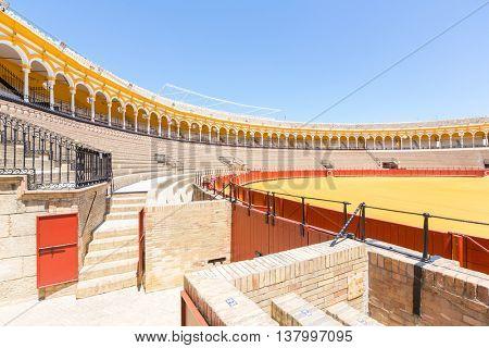 SEVILLE, SPAIN - JUN 4: Bullfight arena, plaza de toros at Sevilla, Spain on June 4, 2014. This is a 12,000-capacity bullring in Seville, Spain.