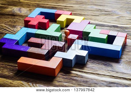The man in the maze. The concept of a business strategy analytics search for solutions the search output. Labyrinth of colorful wooden blocks tetris.