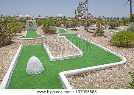 Mini golf course in landscape gardens of luxury tropical hotel resort