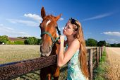 horse and blond girl in paddock on summers day poster
