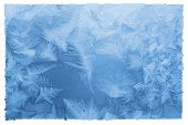 Bright blue frost pattern on a window glass in a white frame (as an abstract winter background) retro style poster