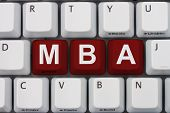 Getting your MBA online A close-up of a keyboard with red highlighted text MBA poster