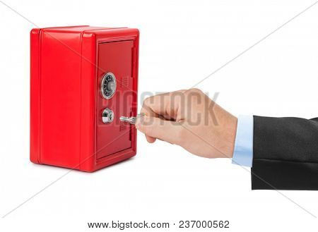 Hand and red toy safe isolated on white background