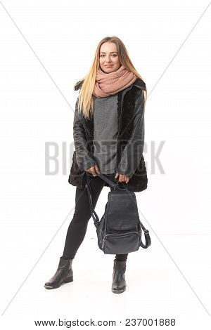 A Girl In Demi-season Clothes With A Full-length Bag On A White Background.