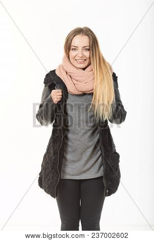 A Girl In Demi-season Clothes With A Bag On A White Background.