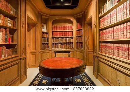 Brussels, Belgium - Apr 2: Many Bookshelves With Old Volumes Of Books And Antique Round Table Inside