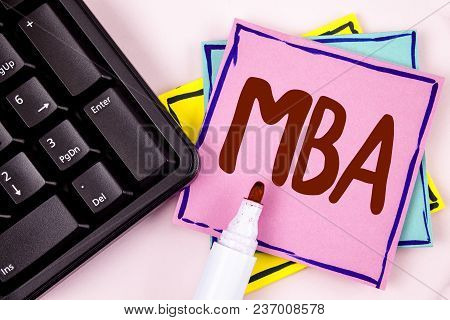 Text sign showing Mba. Conceptual photo Master of Business Administration Advance Degree After College Studies written Pink Sticky Note paper plain background Marker and Black Keyboard. poster