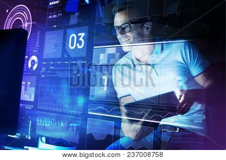 Attentive Specialist. Clever Experienced Software Engineer Smiling While Looking At The Transparent
