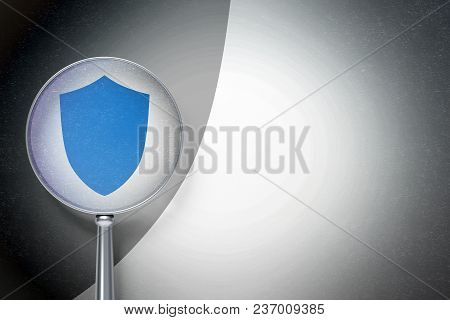 Security Concept: Magnifying Optical Glass With Shield Icon On Digital Background, Empty Copyspace F