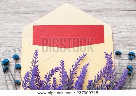 Red Greeting Card In Envelope And Flowers On A Light Wooden Background