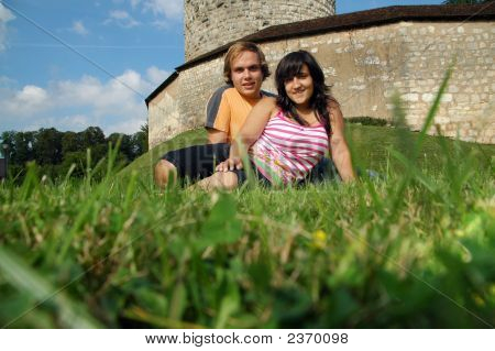 Couple In Green Landscape With Castle