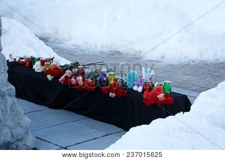 Winter, Snow. A Mourning Memorial With Flowers And Toys After Disaster With The Victims