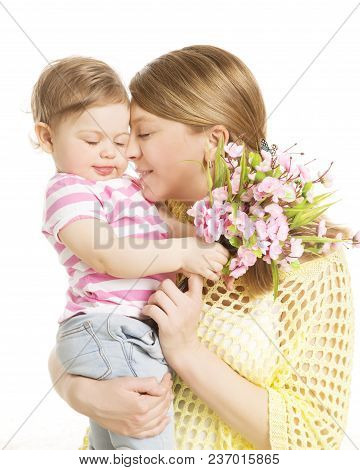 Mother And Baby Gives Flower Bouquet Gift, Mom Embrace Her Daughter, Happy Family With Child Girl On