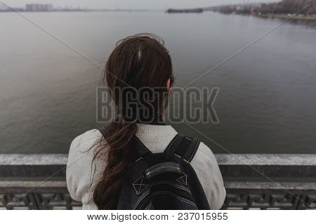Man Is Going To Jump From Bridge. Suicide Concept, View From Back, Toned