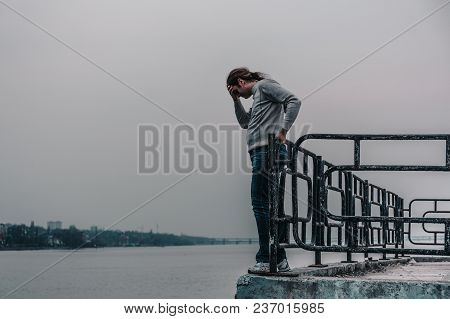 Depressed Man Is Going To Jump From Bridge. Suicide Concept, Copy Space