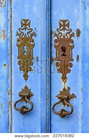 Old And Aged Blue Historic Church Wooden Door In The City Of Ouro Preto, Minas Gerais With Its Rusty