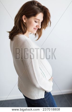 Fashion, Beauty, Motherhood Concept. There Is A Cute Young Lady With Stylish Haircut And She Has A W