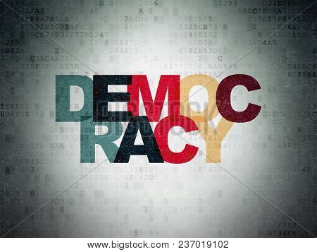 Political Concept: Painted Multicolor Text Democracy On Digital Data Paper Background