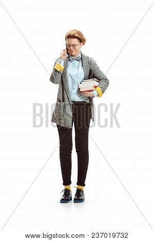 Full Length Portrait Of A Unhappy Female Student In Glasses Holding Books Isolated On White Backgrou