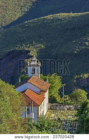 View From The Top And Behind Old Church In The City Of Ouro Preto In Minas Gerais With A Small Grave