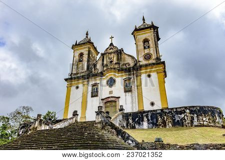 Ancient And Aged Historical Church High In One Of The Several Hills Of The City Of Ouro Preto With D