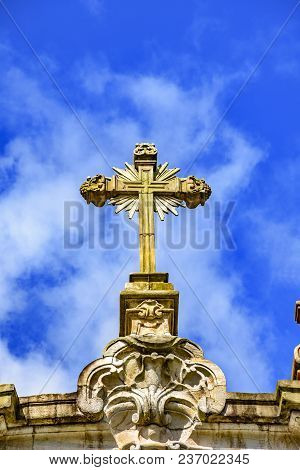 Baroque Style Crucifix On Top Of Ancient And Historical Church In The City Of Ouro Preto In Minas Ge