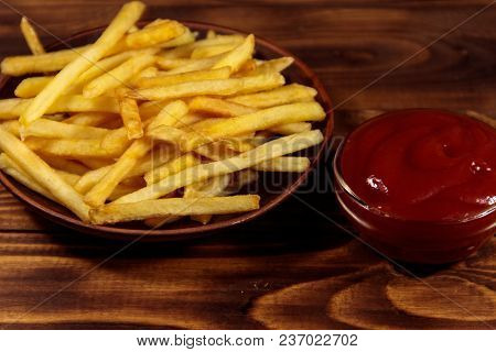French Fries With Ketchup On Wooden Table