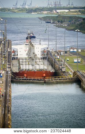 The First Lock Of The Panama Canal From The Atlantic Ocean, Ship Entering The Canal Locks Of Miraflo