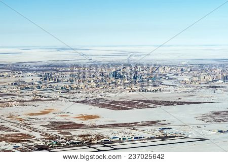 Top View Of Urban Contrasts In Astana, Kazakhstan. View From The Height Of Bird Flight. View From Th