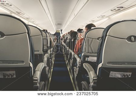Interior Of Airplane With Passengers On Seats Waiting To Taik Off. Horizontal Composition. Boring Fl