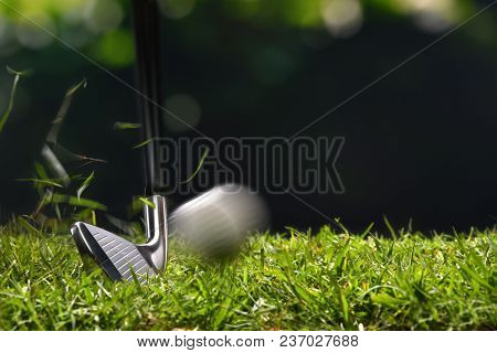 Golfer Hitting Golf Ball With Club On Beatuiful Golf Course