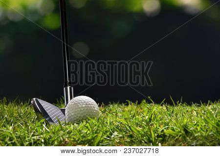 Golf Ball On Green Grass Ready To Be Struck On Golf Course Background