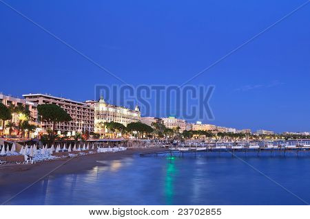 image shows the cosmopolitan city of Cannes in the French Riviera poster