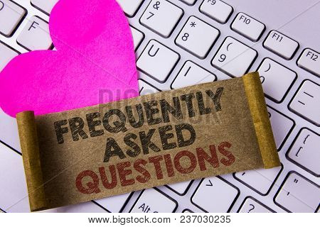 Writing Note Showing  Frequently Asked Questions. Business Photo Showcasing Most Common Inquiries In