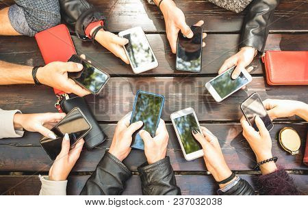 People Group Having Addicted Fun Together Using Smartphones - Detail Of Hands Sharing Content On Soc