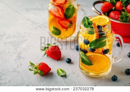 Infused Detox Water With Orange, Blueberry, Strawberry And Mint. Ice Cold Summer Coctail Or Lemonade