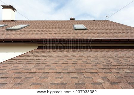 Roofing Construction And Building New House With Modular Chimney, Skylights, Attic, Dormers And Eave
