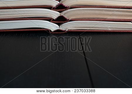 Open Book Hardback On Stack Books On Wooden Background. Back To School With Copy Space.